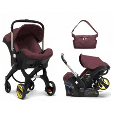 Doona Infant Car Seat with Base and Doona Essentials Bag - Cherry